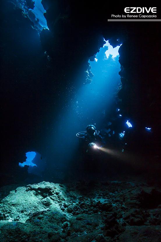 A diver inside First Cathedral at Lanai, Hawaii